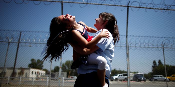 Cori Walters, 32, (R) hugs her daughter Hannah Walters, 6, at California Institute for Women state prison in Chino, California May 5, 2012. An annual Mother's Day event, Get On The Bus, brings children in California to visit their mothers in prison. Sixty percent of parents in state prison report being held over 100 miles (161 km) from their children. Picture taken May 5, 20 REUTERS/Lucy Nicholson (UNITED STATES - Tags: CRIME LAW SOCIETY) ATTENTION EDITORS PICTURE 13 OF 28 FOR PACKAGE 'MOTHER'S DAY BEHIND BARS'